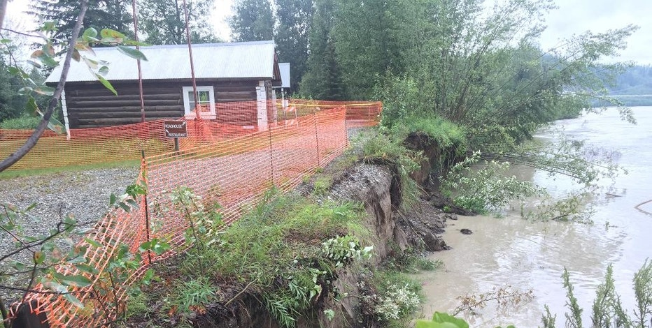This July, 2016, photo, provided by Alaska State Parks, shows an old cabin at Big Delta State Historical Park 90 miles southeast of Fairbanks, Alaska, that was recently moved back 50 feet because of an eroding riverbank. The Alaska State Parks agency is turning to crowdfunding to raise money for erosion protection at the park. (Brooks Ludwig/Alaska State Parks via AP)