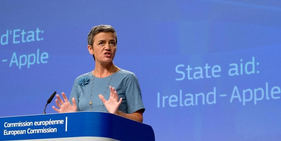 European Union Competition Commissioner Margrethe Vestager speaks during a media conference at EU headquarters in Brussels on Tuesday, Aug. 30, 2016. The European Union says Ireland has given illegal tax benefits to Apple Inc. and must now recover the unpaid back taxes from the U.S. technology company, plus interest. (AP Photo/Virginia Mayo)