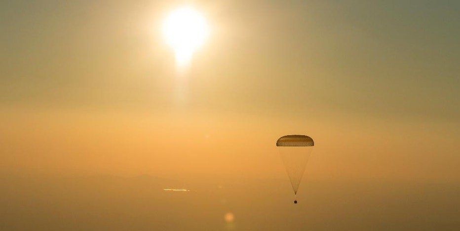 This photo provided by NASA shows the Soyuz TMA-20M spacecraft as it lands with Expedition 48 crew members NASA astronaut Jeff Williams, Russian cosmonauts Alexey Ovchinin, and Oleg Skripochka of Roscosmos near the town of Zhezkazgan, Kazakhstan, Wednesday, Sept. 7, 2016. A record-setting American and two Russians landed safely back on Earth Wednesday after a six-month mission aboard the International Space Station. (Bill Ingalls/NASA via AP)