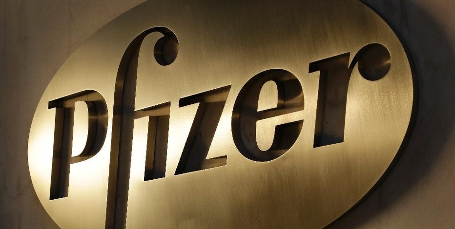 FILE - In this Monday, Nov. 23, 2015, file photo, the Pfizer logo is displayed at world headquarters in New York. After a tax ruling against Apple on Tuesday, Aug. 30, 2016, the spotlight turns to dozens of companies that have boosted earnings taking advantage of low tax rates abroad. Drugmaker Pfizer benefited the most from paying low foreign taxes in 2015, according to an R.G. Associates study. (AP Photo/Mark Lennihan, File)