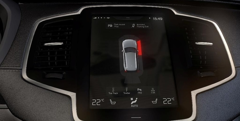 This undated photo provided by Volvo Cars shows the car makers Park Assist System in one of their XC90 SUVs. The system supports the driver during parking. The function expresses audible and visible output to help the driver to determine the distance to stationary and moving objects during parking. It uses four front and four rear ultrasonic sensors positioned symmetrically left to right on the front and rear bumper. Additional four sensors are positioned at the front and rear wheel housing to scan the side of the vehicle. (Volvo Cars via AP)
