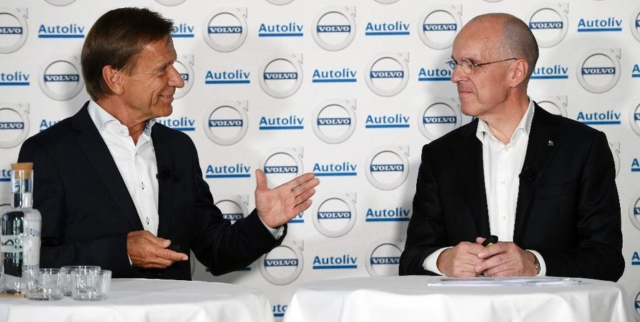 Hakan Samuelsson, left, MD Volvo Cars Group, and Jan Carlson, MD Autoliv, speak during a press conference in Stockholm, Sweden, Tuesday Sept. 6, 2016. Chinese-owned Volvo Cars and Sweden-based automotive safety group Autoliv say they are creating a jointly-owned company to develop autonomous driving software for Volvo cars. (Henrik Montgomery/TT via AP)