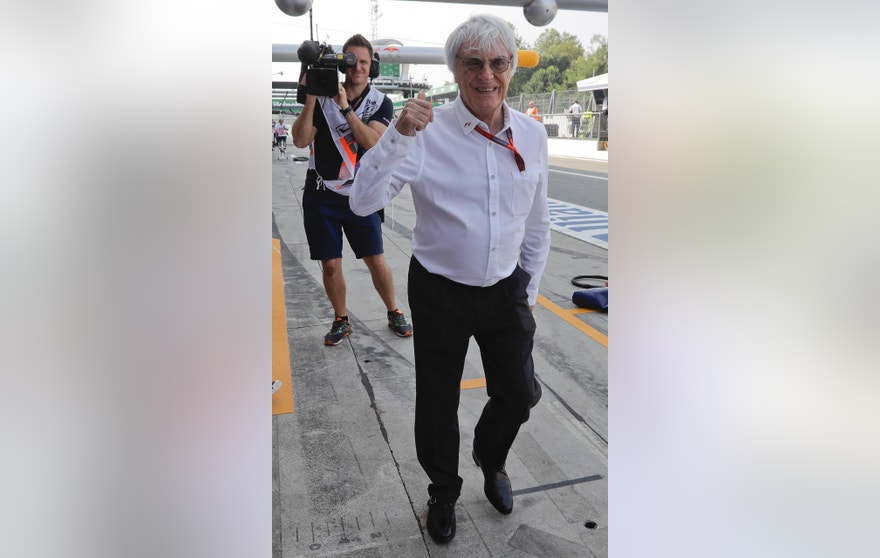 Chief Executive for the Formula One Group, Bernie Ecclestone, gives the thumb-up sign during the first practice session for Sunday's Italian Formula One Grand Prix at the Monza racetrack, Italy, Friday, Sept. 2, 2016.