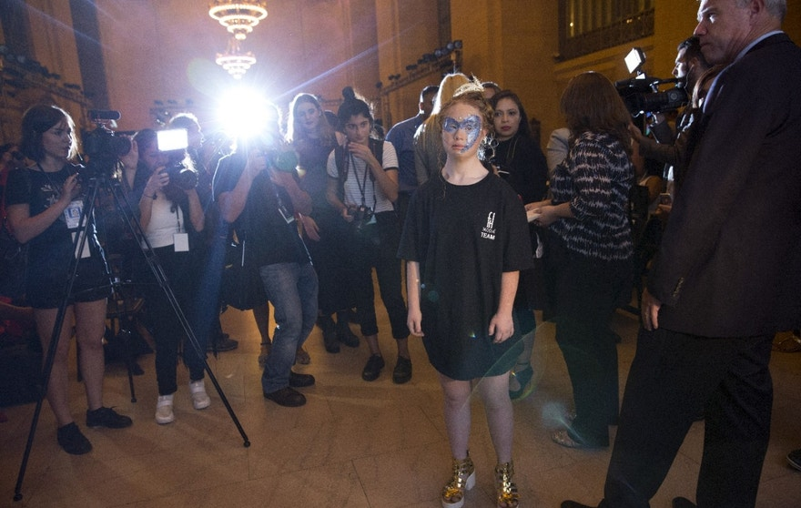Madeline Stuart, an Australian model with Down Syndrome is flanked by the media after participating in the FTL Moda presentation of the Spring/Summer 2016 collection during New York Fashion Week in Vanderbilt Hall at Grand Central Station, New York, September 13, 2015. FTL Moda presented a range of designers and partnered with the Christopher & Dana Reeve Foundation and Global Disability Inclusion. The show casted a diverse range of models, including models living with disabilities. REUTERS/Andrew Kelly - RTSXU1