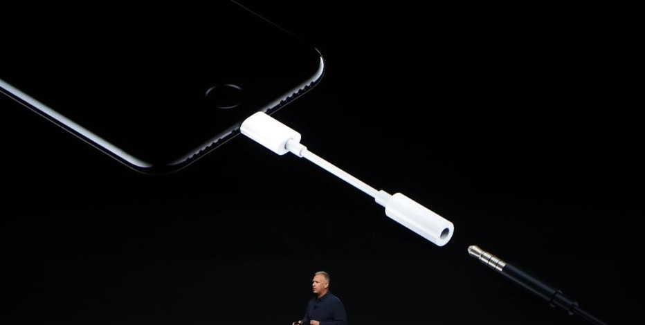 FILE - In this Sept. 7, 2016, file photo, Phil Schiller, Apple's senior vice president of worldwide marketing, talks about the features on the new iPhone 7 earphone options during an event to announce new products, in San Francisco. The new iPhones are better, even when considering that the most dramatic change is what got taken away: the traditional headphone jack. Without a traditional headphone jack, wired headphones plug into the Lightning port normally used for charging. A 3-inch-long adapter is included for your old headphones. (AP Photo/Marcio Jose Sanchez, File)