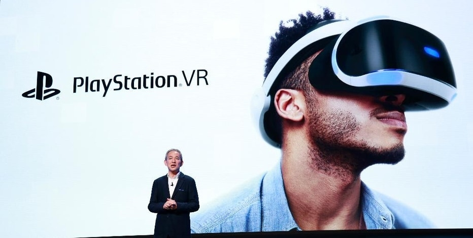 Sony Interactive Entertainment Japan Asia President Atsushi Morita speaks during a PlayStation event in Tokyo, Tuesday, Sept. 13, 2016. Sony Corp.'s video game division is readying not just games but also music, movies and other kinds of entertainment for its Virtual Reality headgear, set to go on sale next month. (AP Photo/Shizuo Kambayashi)