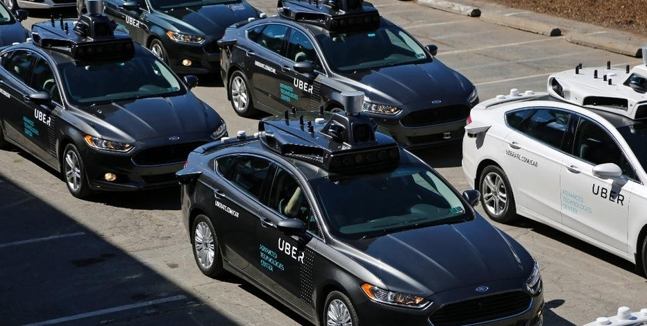 A group of self driving Uber vehicles position themselves to take journalists on rides during a media preview at Uber's Advanced Technologies Center in Pittsburgh, Monday, Sept. 12, 2016. Starting Wednesday morning, Sept. 14, 2016 dozens of self-driving Ford Fusions will pick up riders who opted into a test program with Uber. While the vehicles are loaded with features that allow them to navigate on their own, an Uber engineer will sit in the driver's seat and seize control if things go awry. (AP Photo/Gene J. Puskar)