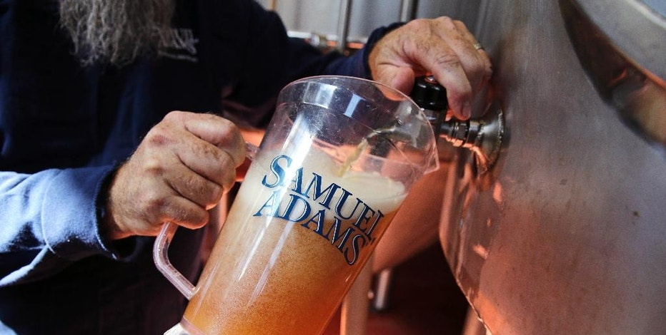 """Master brewer Bob Cannon, of the Samuel Adams Boston Brewery, pours a pitcher of their """"80-Miles of Helles"""" beer, which is made using water from Boston's Charles River, Thursday, Sept. 15, 2016, in Boston. Leading New England breweries are competing to see who can turn the questionable water of Boston's Charles River into the tastiest suds. (AP Photo/Charles Krupa)"""