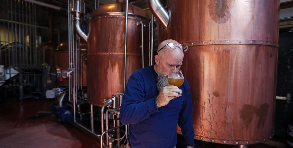 "Master brewer Bob Cannon, of the Samuel Adams Boston Brewery, smells the aroma of their ""80-Miles of Helles"" beer, which is made using water from Boston's Charles River, Thursday, Sept. 15, 2016, in Boston. Leading New England breweries are competing to see who can turn the questionable water of Boston's Charles River into the tastiest suds. (AP Photo/Charles Krupa)"