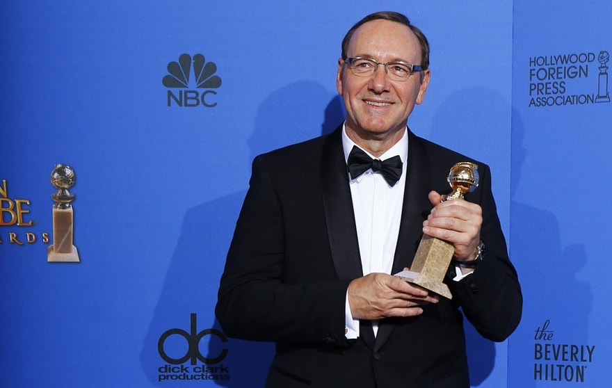 """Actor Kevin Spacey poses backstage with his award for Best Performance by an Actor in a Television Series for """"House of Cards"""" during the 72nd Golden Globe Awards in Beverly Hills, California January 11, 2015."""