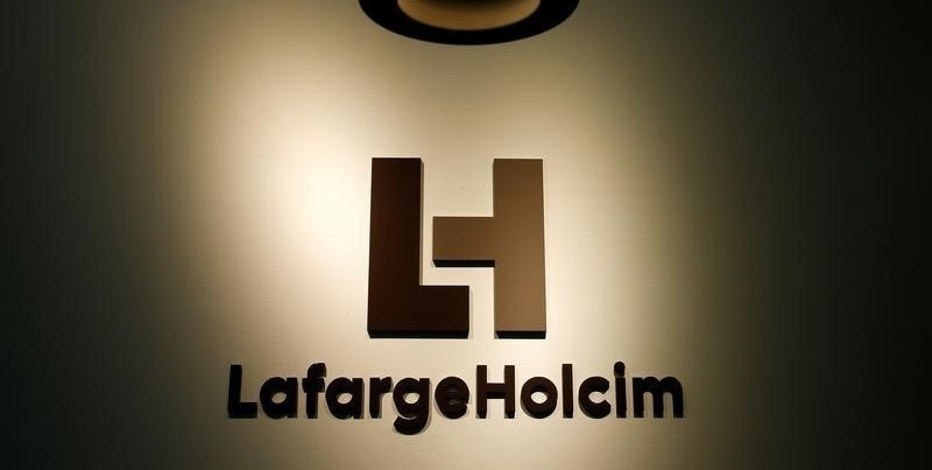 The company's new logo is pictured at the headquarters of LafargeHolcim in Zurich, Switzerland, July 15, 2015.  REUTERS/Arnd Wiegmann/File Photo