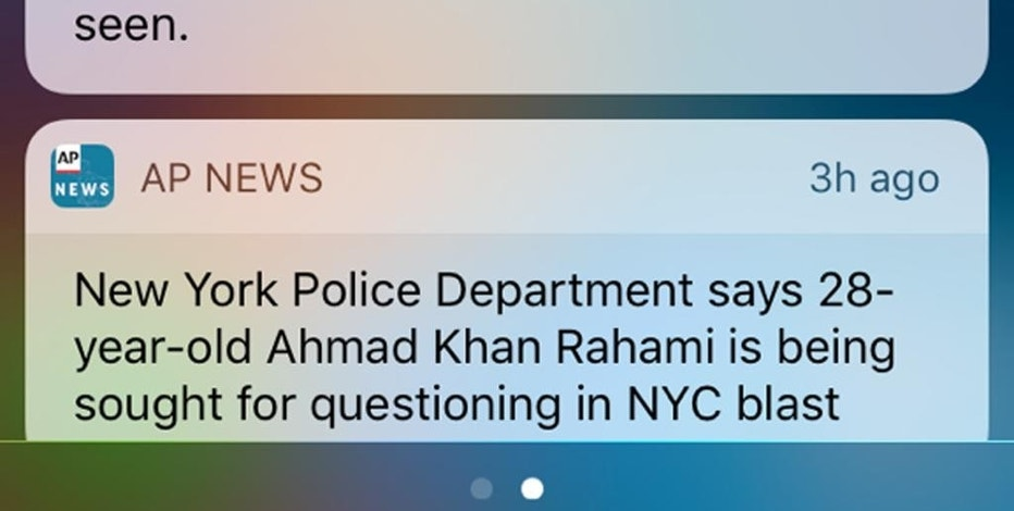 This frame grab from a cellphone shows an emergency alert along with a news alert on Monday, Sept. 19, 2016, about a man wanted in connection with explosions in the New York City metropolitan area. The Associated Press takes a look at these wireless emergency alerts and how they work. (AP Photo)