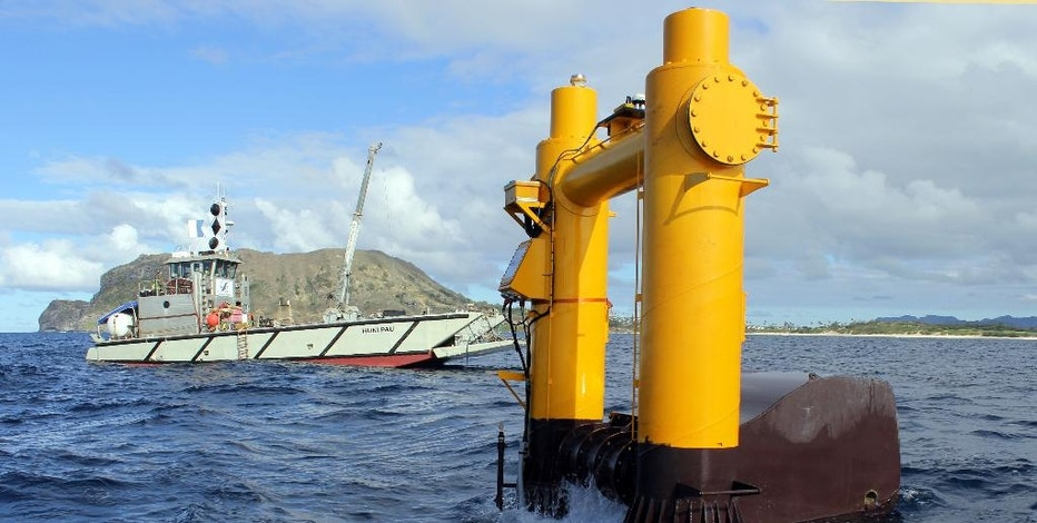 This 2015 photo provided by Northwest Energy Innovations shows the Azura wave energy device, which is converting the movement of waves into electricity at the Navy's Wave Energy Test Site at the Marine Corps base at Kaneohe Bay on Oahu in Hawaii. By some estimates, the ocean's endless motion packs enough power to meet a quarter of America's energy needs and dramatically reduce the nation's reliance on oil, gas and coal. But wave energy technology lags well behind wind and solar power. (Steven Kopf/Northwest Energy Innovations via AP)