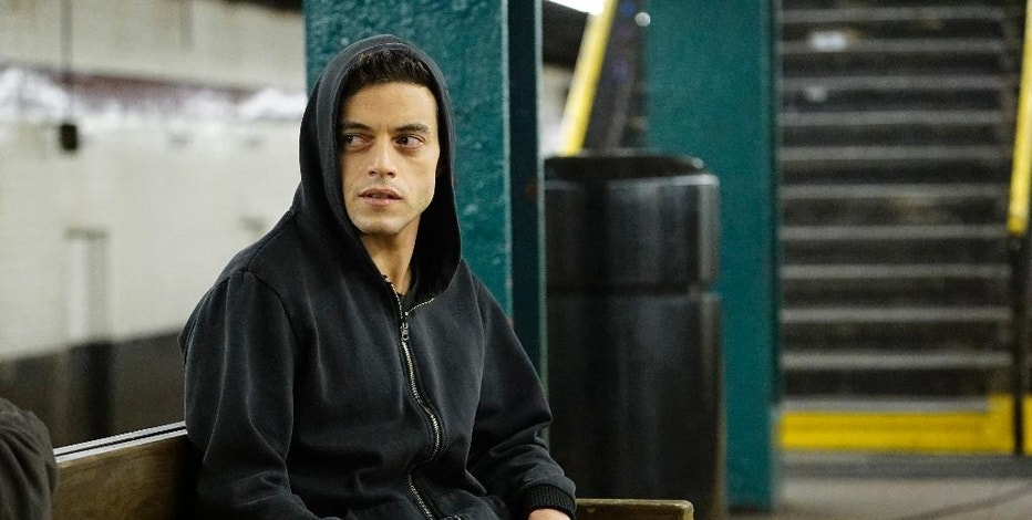 "FILE - In this file image provided by USA Network, Rami Malek appears in a scene from, ""Mr. Robot."" The creative team behind the award-winning ""Mr. Robot"" knows that if it doesn't get details right, they're going to hear about it. Unlike other shows about hackers, ""Mr. Robot,"" which wraps up its second season on Sept. 21, 2016, has been praised by the hacker community for realistically portraying what they do. (Peter Kramer/USA Network via AP, File)"