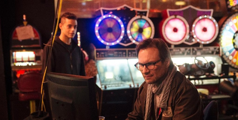 "FILE - This file photo provided by USA Networks shows, Rami Malek, left, as Elliot, and Christian Slater as Mr. Robot in a scene from the pilot episode of the television series, ""Mr. Robot."" The creative team behind the award-winning ""Mr. Robot"" knows that if it doesn't get details right, they're going to hear about it. Unlike other shows about hackers, ""Mr. Robot,"" which wraps up its second season on Sept. 21, 2016, has been praised by the hacker community for realistically portraying what they do. (David Giesbrecht/USA Network via AP, File)"