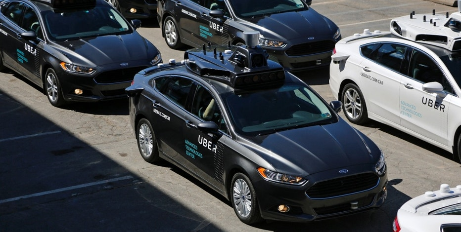 A group of self driving Uber vehicles position themselves to take journalists on rides during a media preview at Uber's Advanced Technologies Center in Pittsburgh, Monday, Sept. 12, 2016.