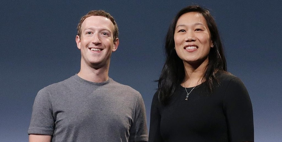 In this Tuesday, Sept. 20, 2016, photo, Facebook CEO Mark Zuckerberg, left, and his wife, Priscilla Chan, smile as they rehearse for a speech in San Francisco. Zuckerberg and Chan have a new lofty goal: to cure, manage or eradicate all disease by the end of this century. To this end, the Chan Zuckerberg Initiative, the couple's philanthropic organization, is committing significant financial resources over the next decade to help accelerate basic science research. (AP Photo/Jeff Chiu)