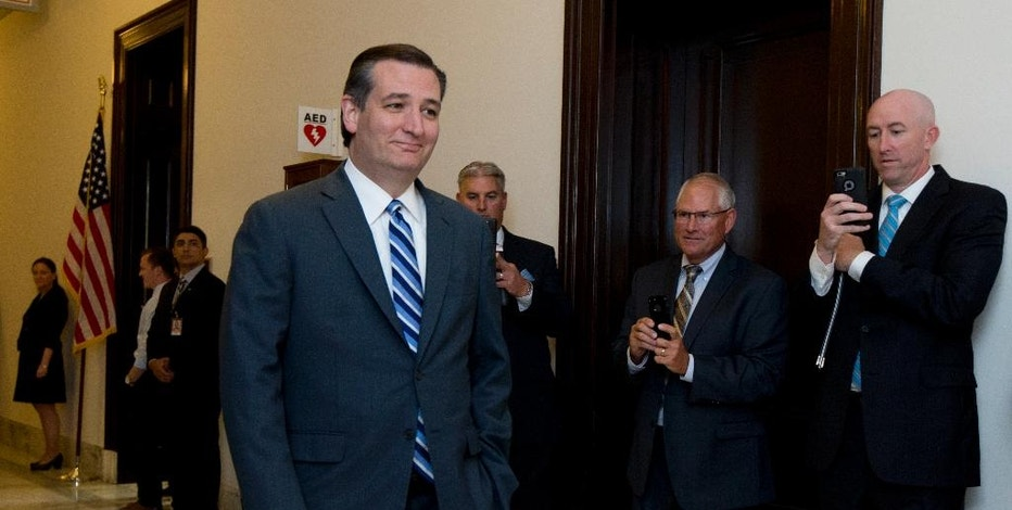 FILE - In this May 10, 2016 file photo, Sen. Ted Cruz, R-Texas, walks past reporters as he returns to the Capitol Hill in Washington. Donald Trump's campaign says a looming government plan to disengage from managing key operations of the internet poses a threat of government censorship of online information. But such an outcome is highly unlikely.  (AP Photo/Manuel Balce Ceneta, File)