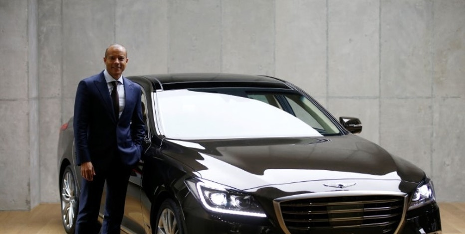 Manfred Fitzgerald, head of Hyundai's Genesis brand, poses for photographs next to the Genesis G80 during an interview with Reuters at the Genesis Studio in Hanam, South Korea, September 8, 2016. REUTERS/Kim Hong-Ji