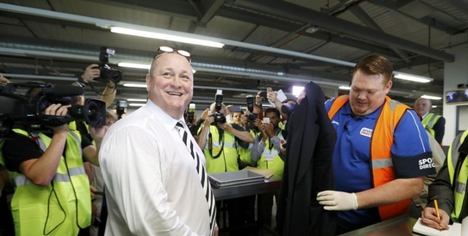 Mike Ashley (L), founder and majority shareholder of sportwear retailer Sports Direct, leads journalists on a factory tour after the company's AGM, at the company's headquarters in Shirebrook, Britain, September 7, 2016. REUTERS/Darren Staples