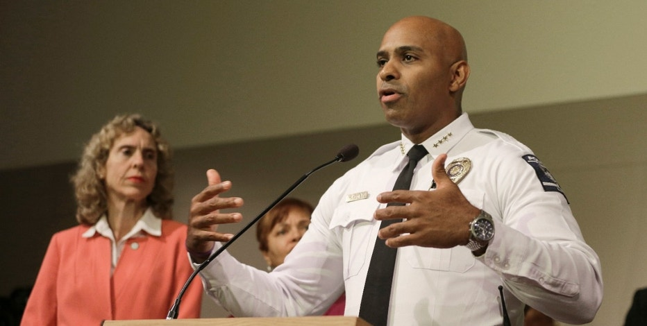 "FILE - In this Friday, Sept. 23, 2016 file photo, Charlotte-Mecklenburg Police chief Kerr Putney, right, gestures as Charlotte mayor Jennifer Roberts, left, watches in Charlotte, N.C., during a news conference concerning protests and the investigation into Tuesday's fatal police shooting of Keith Lamont Scott. Putney told reporters Friday that at least one body camera and one dashboard camera recorded footage of the shooting. He said ""it's a matter of when"" the video will be released.  (AP Photo/Chuck Burton, File)"