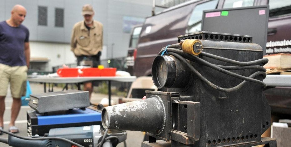 In this Sept. 18, 2016, photo, a photo slide Magic Lantern projector, circa 1930, is displayed at MIT's Radio Society flea market on the campus of the Massachusetts Institute of Technology in Cambridge, Mass. Every third Sunday, MIT's Radio Society hosts a parking-lot flea market that's part yard sale and part curio museum from the world of electronics. Vendors come to hawk radio equipment, but also vintage Macintosh computers, castaway musical instruments, baubles of all kinds and the occasional space capsule. The storied market is part of a circuit of flea markets hosted by radio clubs across New England, but this one is known for attracting the strangest of wares. (AP Photo/Collin Binkley)
