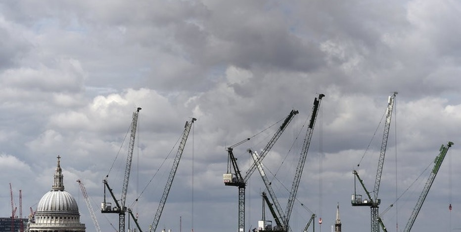 Construction cranes are seen around St. Paul's Cathedral in London, Britain, September 3, 2015. REUTERS/Toby Melville/File Photo