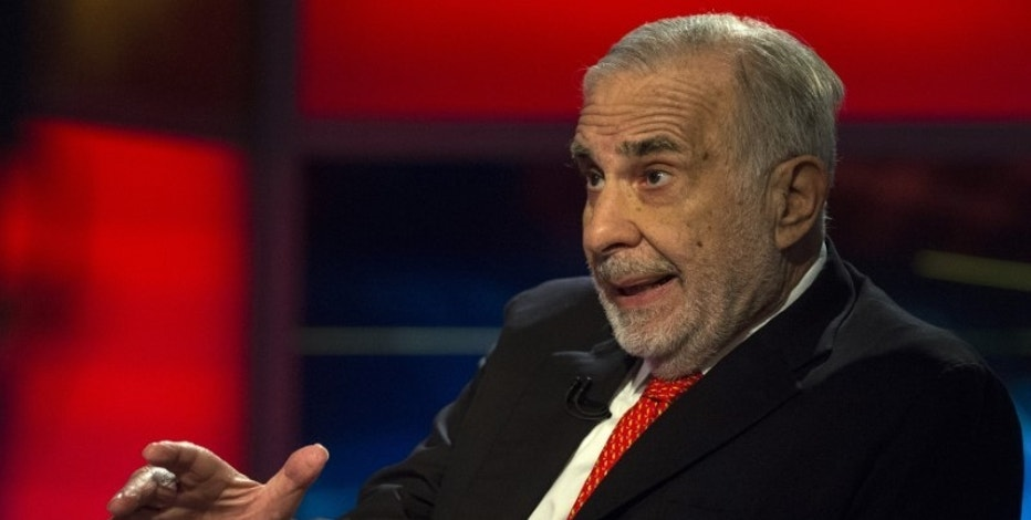 Billionaire activist-investor Carl Icahn gives an interview on FOX Business Network's Neil Cavuto show in New York February 11, 2014.  Icahn has backed off from his campaign urging Apple to increase its stock buybacks, citing the company's recent repurchases as well as an influential proxy adviser's call against his proposal.   REUTERS/Brendan McDermid (UNITED STATES - Tags: BUSINESS MEDIA) - RTX18MUL