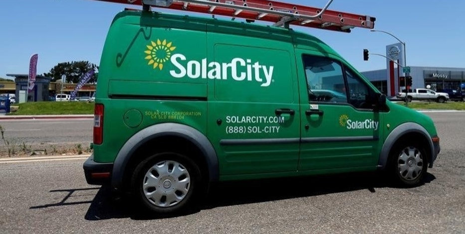 A SolarCity vehicle is seen on the road in San Diego, California, U.S. June 22, 2016.        REUTERS/Mike Blake/File Photo