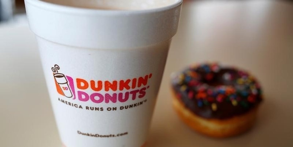 A drink and a doughnut are seen at a Dunkin' Donuts location in the Chicago suburb of Niles, Illinois, February 4, 2015.  REUTERS/Jim Young/File Photo