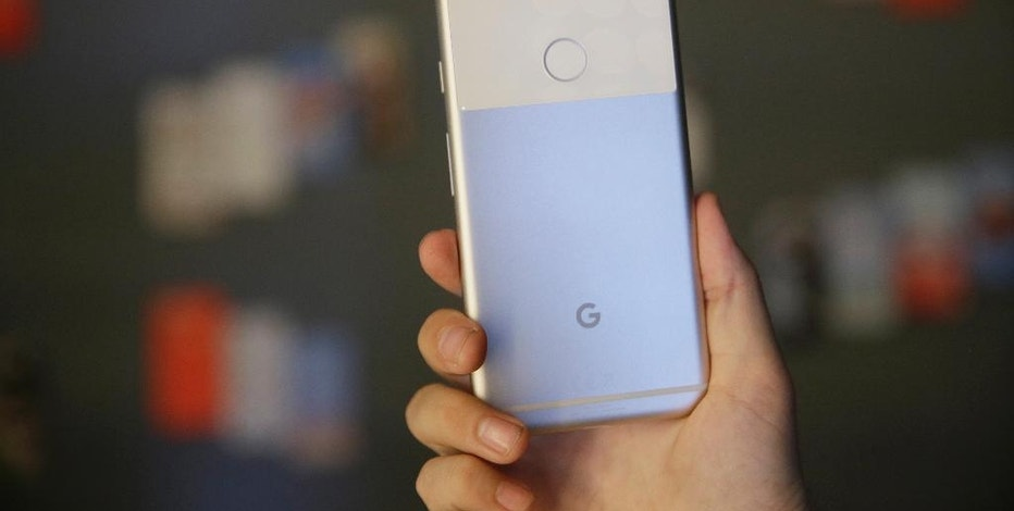"""The new Google Pixel phone is displayed following a product event, Tuesday, Oct. 4, 2016, in San Francisco. Google launched an aggressive challenge to Apple and Samsung introducing its own new line of smartphones called Pixel, which are designed to showcase a digital helper the company calls """"Google Assistant."""" The new phones represent a big, new push by Google to sell its own consumer devices, instead of largely just supplying software for other manufacturers. (AP Photo/Eric Risberg)"""