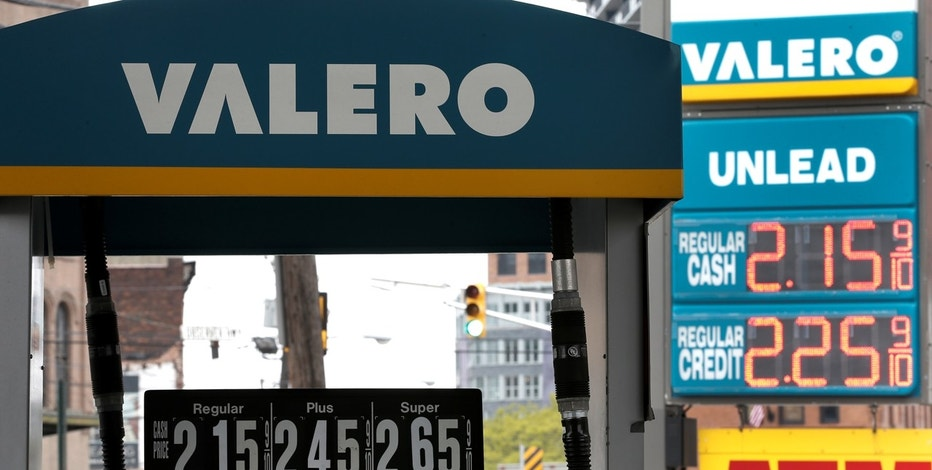 Signs are seen at a Valero gas station in Hoboken, New Jersey, U.S., May 2, 2016.
