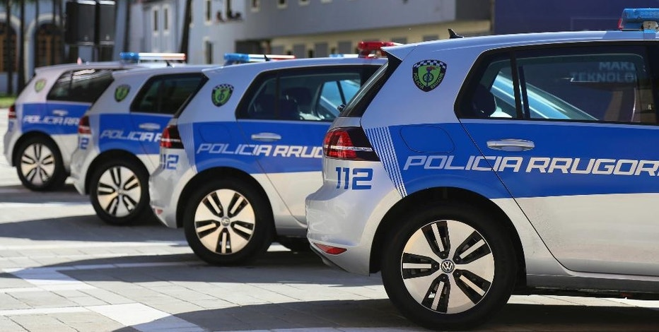 """New electric cars on display to be used by the Albanian police in the capital Tirana, Wednesday, Oct. 5, 2016. Interior Minsiter Saimir Tahiri said Albanian police will be the first in the region, and one of five countries in Europe, using electric cars that use  """"not a single drop of fuel."""" But they have to return to police stations to be recharged, as there are no recharging facilities at fuel stations or around the cities.  (AP Photo/Hektor Pustina)"""