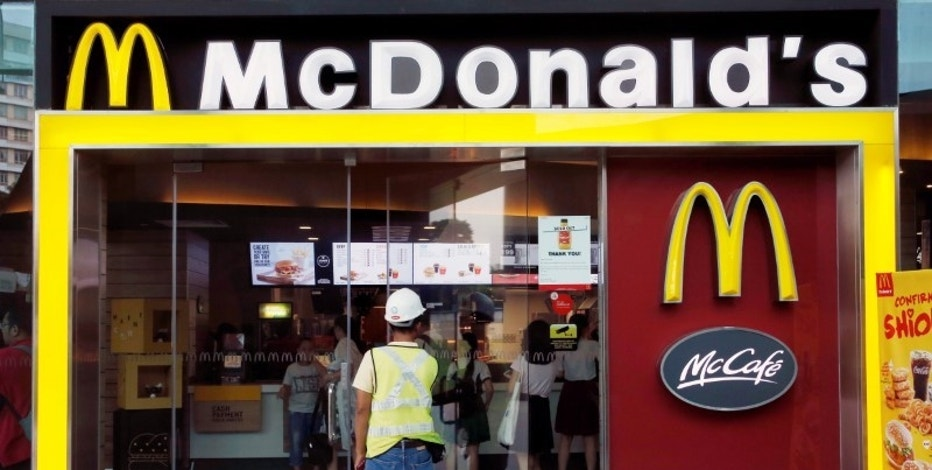 A man enters a McDonald's restaurant in Singapore July 25, 2016. Picture taken July 25, 2016. REUTERS/Edgar Su