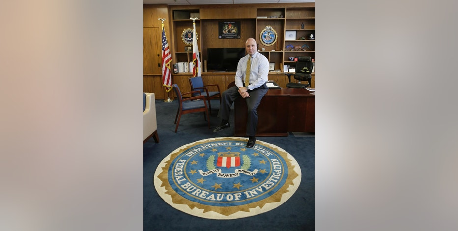 In this photo taken Tuesday, Sept. 27, 2016, FBI Special Agent Jack Bennett poses in his office in San Francisco. The FBI's new leader in San Francisco is a former drug investigator who developed expertise in technology that put him at the center of the government's effort to unlock an iPhone used by one of the San Bernardino shooters. Bennett now has oversight responsibilities for Silicon Valley. (AP Photo/Eric Risberg)