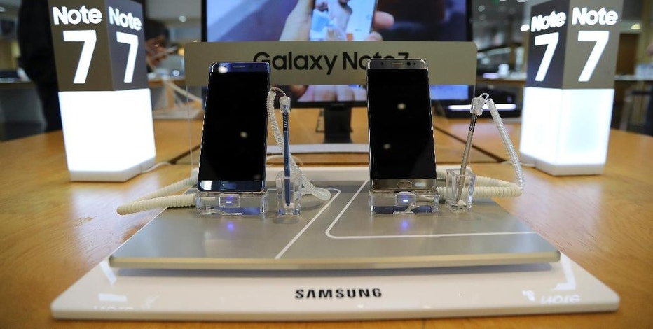 In this photo taken on Wednesday, Oct. 5, 2016, Samsung Electronics Galaxy Note 7 smartphones are displayed at its shop in Seoul, South Korea. Samsung Electronics Co. estimated its profit rose more than expected in the July-September quarter despite the unprecedented recall of its flagship smartphones. (AP Photo/Lee Jin-man)