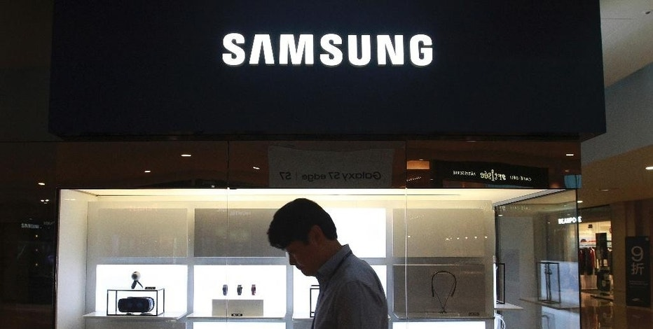 A man passes by a Samsung Electronics shop in Seoul, South Korea, Wednesday, Oct. 12, 2016. The fiasco of Samsung's fire-prone Galaxy Note 7 smartphones - and Samsung's stumbling response to the problem - has left consumers from Shanghai to New York reconsidering how they feel about the South Korean tech giant and its products. (AP Photo/Ahn Young-joon)