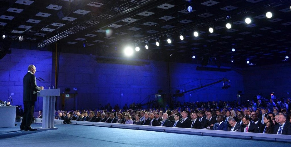 "Russian President Vladimir Putin, left, speaks at the 8th annual VTB Capital ""Russia Calling!"" Investment Forum in in Moscow, Russia, Wednesday, Oct. 12, 2016.Russia's economy has been on its way down since it slipped into recession at the start of last year. (Alexei Druzhinin, Sputnik,  Kremlin Pool Photo via AP)"