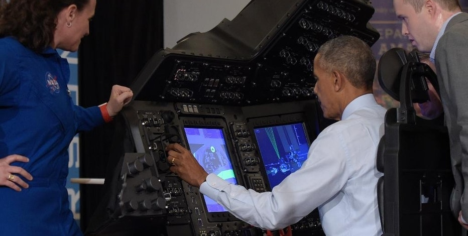 President Barack Obama sits in a flight simulator during a tour of innovation projects at the White House Frontiers Conference at University of Pittsburgh in Pittsburgh, Thursday, Oct. 13, 2016. NASA astronaut Dr. Serena Aunon-Chancellor, left, and Boeing Representative Daniel Nelson, right, watch. Obama was operating a spacecraft flight and docking simulator that replicates the training setup that NASA's commercial crew astronauts are using to prepare for future missions to the International Space Station. (AP Photo/Susan Walsh)