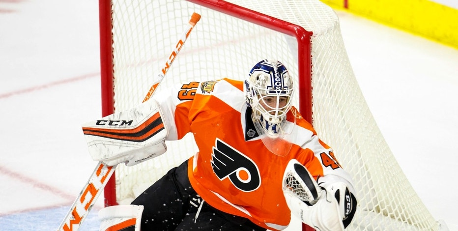 Philadelphia Flyers' Alex Lyon makes the glove save during the third period of a preseason NHL hockey game against the New Jersey Devils, Wednesday, Sept. 28, 2016, in Allentown, Pa. The Flyers won 2-0. (AP Photo/Chris Szagola)