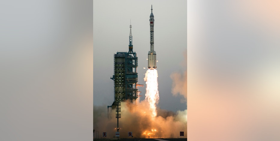 China's Shenzhou 11 spaceship onboard a Long March-2F carrier rocket takes off from the Jiuquan Satellite Launch Center in northwest China's Gansu province on Monday Oct. 17, 2016.  China launched a pair of astronauts into space Monday on a mission to dock with an experimental space station and remain aboard for 30 days in preparation for the assembly of a full facility six years from now.(Chinatopix via AP)