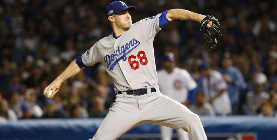 Los Angeles Dodgers relief pitcher Ross Stripling (68) throws during the seventh inning of Game 1 of the National League baseball championship series against the Chicago Cubs Saturday, Oct. 15, 2016, in Chicago.