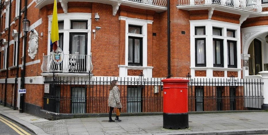 A woman walks past the Ecuadorian Embassy in London, Tuesday, Oct. 18, 2016. Midway through releasing a series of damaging disclosures about U.S. presidential contender Hillary Clinton, WikiLeaks founder Julian Assange says his hosts at the Ecuadorean Embassy in London abruptly cut him off from the internet. The news adds another layer of intrigue to an extraordinary campaign. (AP Photo/Alastair Grant)