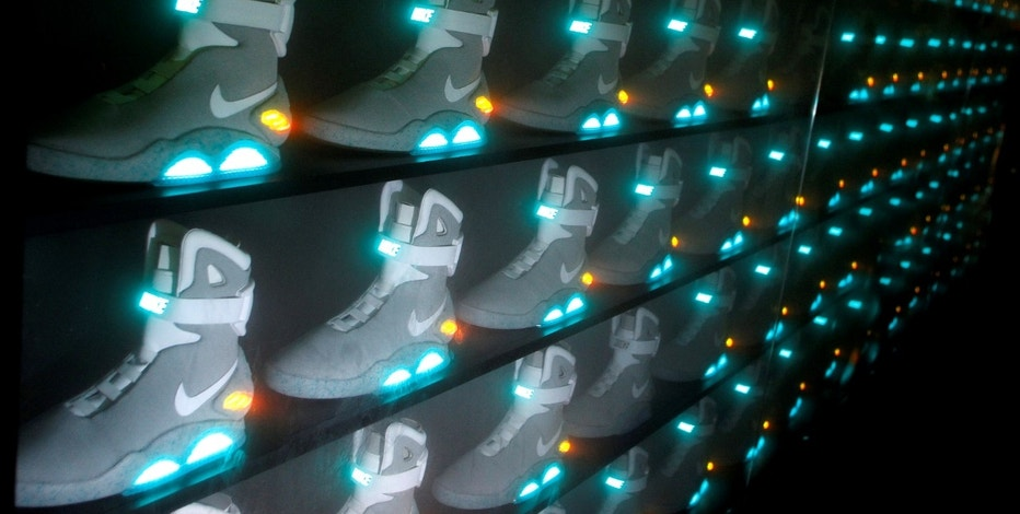 """2011 NIKE MAG shoes, based on the original NIKE MAG worn in 2015 by the """"Back to the Future"""" character Marty McFly, played by Michael J. Fox, are displayed during its unveiling at The Montalban Theatre in Hollywood, California September 8, 2011.  REUTERS/Danny Moloshok/File Photo                   GLOBAL BUSINESS WEEK AHEAD PACKAGE - SEARCH BUSINESS WEEK AHEAD SEPTEMBER 26 FOR ALL IMAGES - RTSPE7I"""