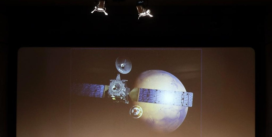 A rendering of the Schiaparelli Space Module and of the planet Mars is displayed on a movie screen during an event organized by Italy's Space Agency on the occasion of the insertion of the Trace Gas Orbiter into orbit around Mars, and the landing of Schiaparelli module on the surface of of the planet, in Rome, Friday, Oct. 19, 2016. (AP Photo/Gregorio Borgia)