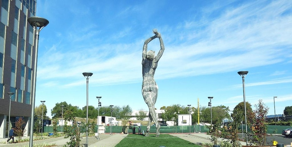 "In this photo taken Wednesday Oct. 19, 2016, a 55-foot nude statue stands in San Leandro, Calif. The statue of a naked woman is stirring controversy and a lot of conversation. City officials and the sculptor of the steel nude, which was unveiled this week across from San Leandro's main commuter train stop, say they want to draw attention to ""feminine energy."" Critics say the 13,000-pound towering nude is not appropriate public art. (AP Photo/Jocelyn Gecker)"