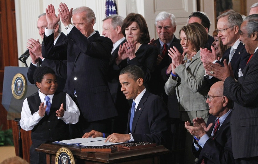 FILE - In this March 23, 2010 file photo, President Barack Obama is applauded after signing the health care bill in the East Room of the White House in Washington. The nine justices of the Supreme Court, who serve without seeking election, soon will have to decide whether to insert themselves into the center of the nation's presidential campaign next year.  The high court begins its new term Monday, Oct. 3, 2011, and President Barack Obama's health care overhaul, which affects almost every American, is squarely in its sights.  (AP Photo/Charles Dharapak, File)