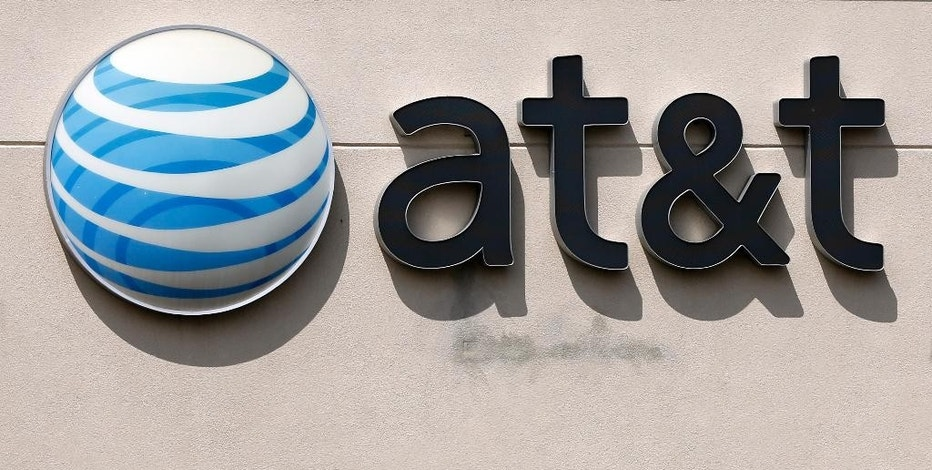FILE - This May 14, 2014 file photo shows an AT&T logo on a store in Dedham, Mass. On Saturday, Oct. 22, 2016, several reports citing unnamed sources said the giant phone company is in advanced talks to buy Time Warner, owner of the Warner Bros. movie studio as well as HBO and CNN. AT&T is said to be offering $80 billion or more, a massive deal that would shake up the media landscape. (AP Photo/Steven Senne, File)