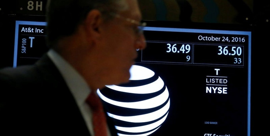 Ticker and trading information for telecoms company AT&T are displayed at the post where it is traded on the floor of the New York Stock Exchange (NYSE) in New York City, U.S., October 24, 2016.  REUTERS/Brendan McDermid