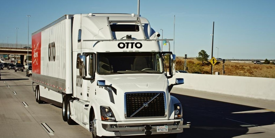 This October 2016 photo provided by Anheuser-Busch shows a self-driving truck that delivers beer, in Colorado. Anheuser-Busch said it completed the world's first commercial shipment by self-driving truck, sending a beer-filled tractor-trailer on a journey of more than 120 miles through Colorado. (Kyle Bullington/Otto/Anheuser-Busch via AP)